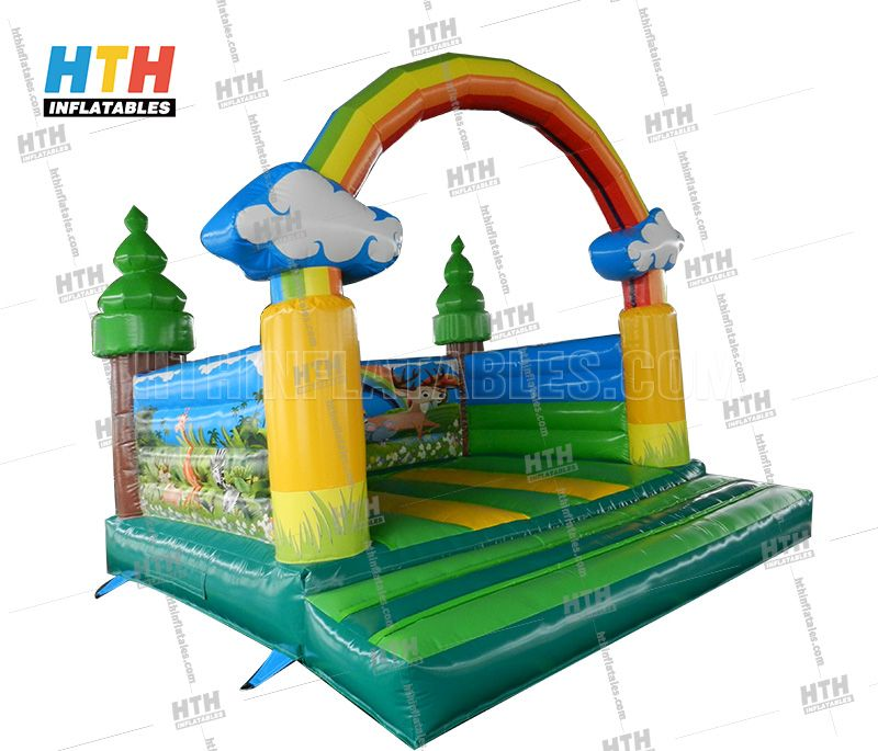 Rainbow Bounce House for indoor birthday party