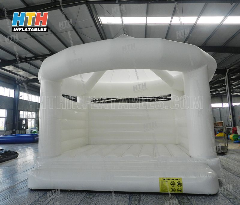 White bounce house for wedding party